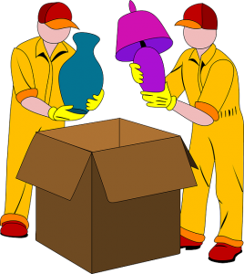 Two men packing household items.