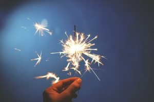 A sparkler representing holidays which are not the cheapest time to relocate