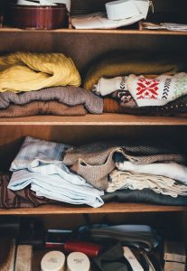 A cabinet with clothes