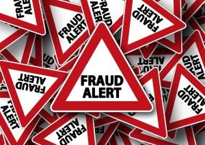 A sign saying fraud alert