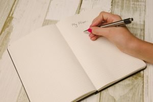 "A notebook with ""my plan"" written on it. To unpack efficiently after moving, make sure you plan it out in advance."