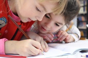two little girls doing homework