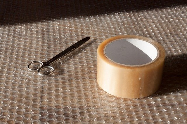 Scissors, tape, and bubble wrap - packing supplies