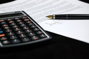 A calculator and a contract.