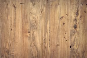 Cover hardwood floors when moving in bad weather.