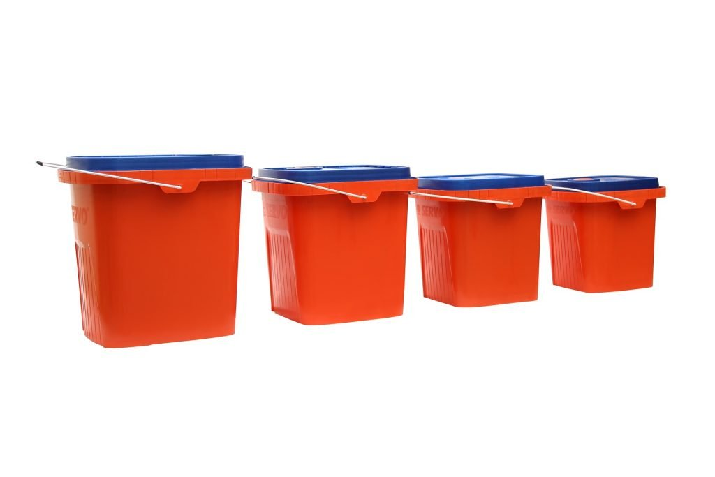 Four red plastic bins.