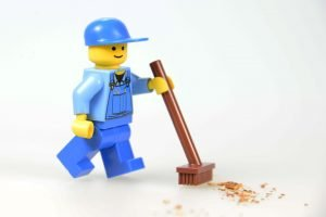 A lego figurine cleaning