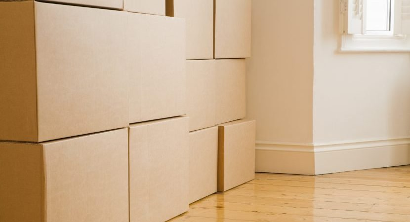 Stacks of boxes in new home - something our movers Lewisville can handle for you