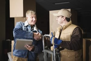 A man shaking hands with one of the movers
