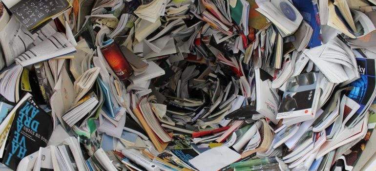 Pile of books and papers waiting on you to downsize them after you move.