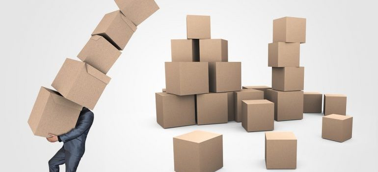 Putting boxes vertically in order to create extra space in your storage unit