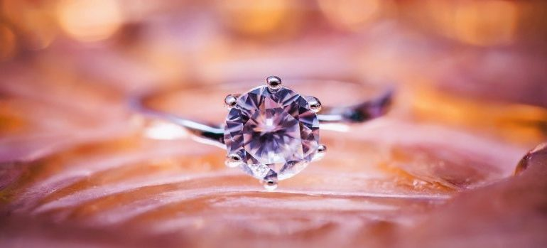 Diamond ring on a pink surface - Tips for moving your valuables