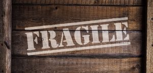 """Crate with """"fragile"""" written on it"""