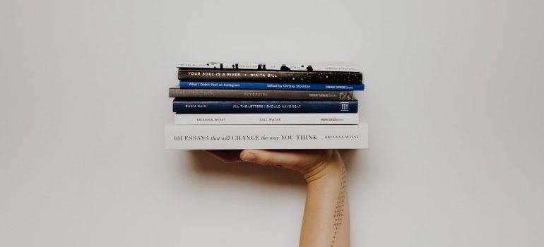person holding books in one hand
