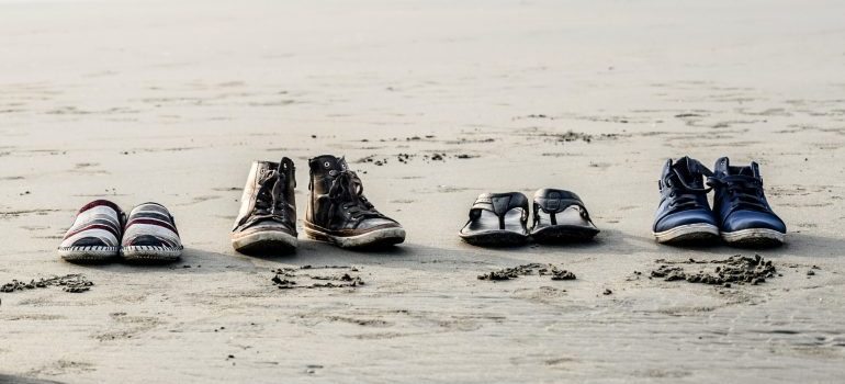 different shoes on the beach