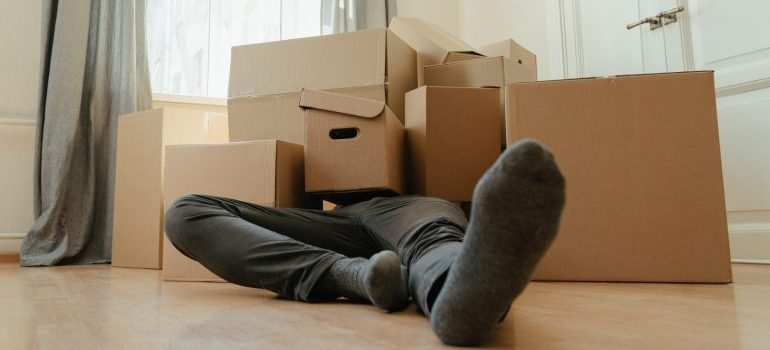 Man under moving boxes-speed up relocation