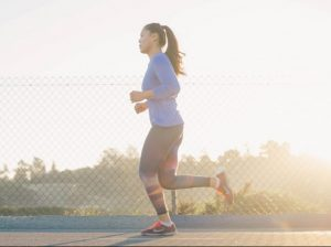 A woman jogging, which is a great way to deal with post-moving depression