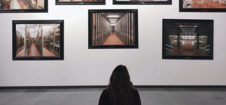 A girl sitting in order to observe art.