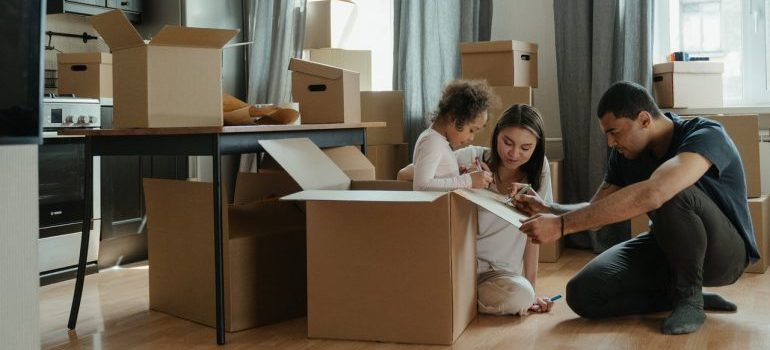 Family unpacking after moving to Irving from Plano