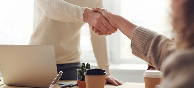 Two people shaking hands in a job interview