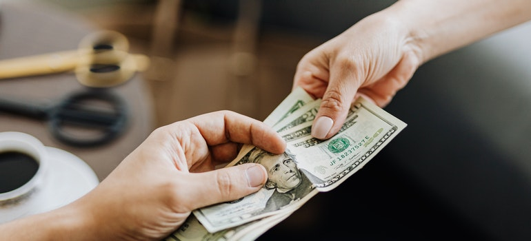 One person giving money to another