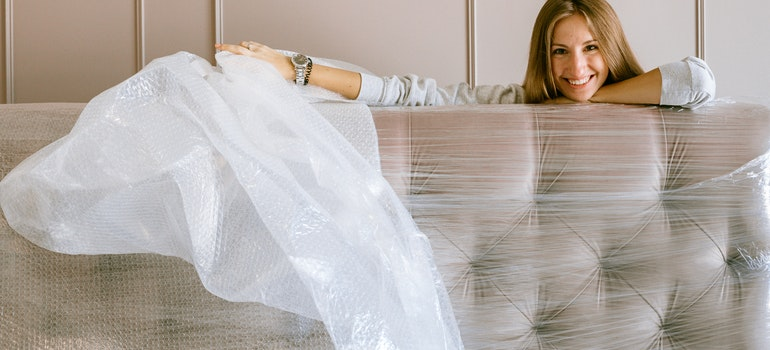 Woman wrapping a couch
