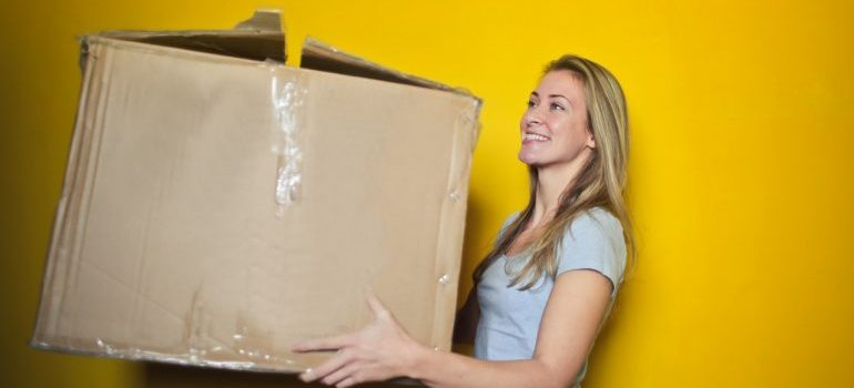 Girl holding a moving box