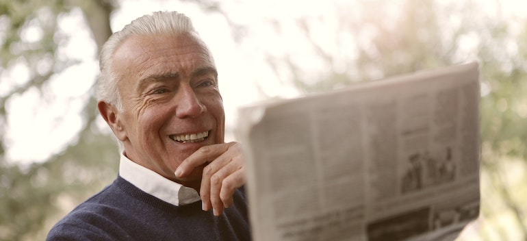 a man looking at the papers
