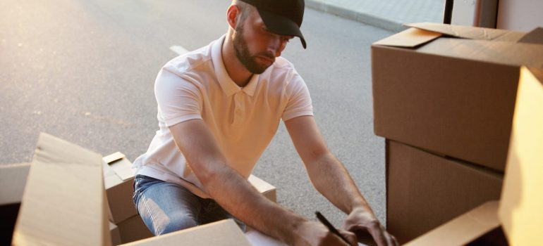 Man preparing for moving to family friendly Texas cities by checking his inventory.