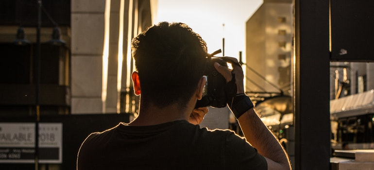 Man taking a picture of sunset