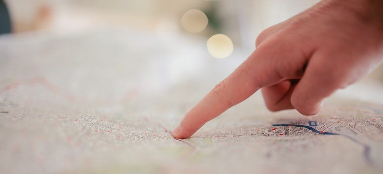 Guy pointing on map