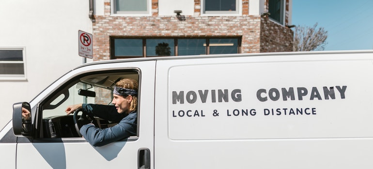 Man in moving company van helping when moving from Arlington to Fort Worth