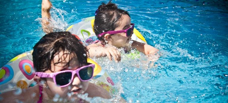 Two girls swimming